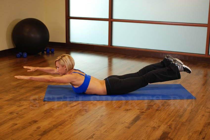 Упражнение для спины ласточка лежа